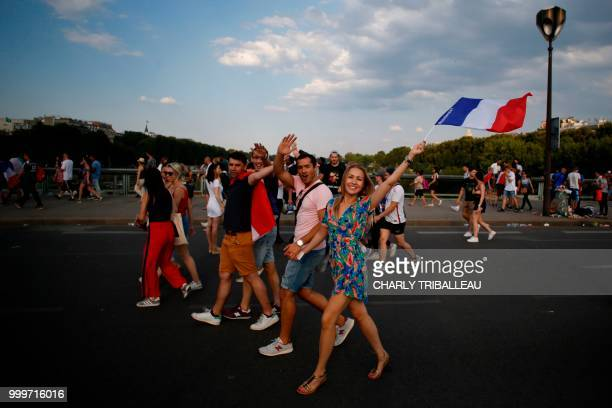 France supporters celebrate as they leave the fan zone on the Champ de Mars in Paris on July 15 after France won the Russia 2018 World Cup final...