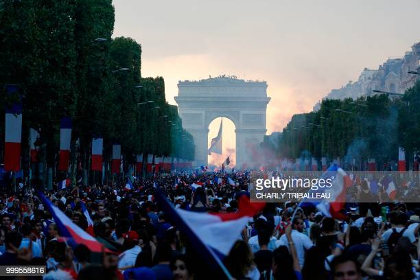 TOPSHOT France supporters celebrate on the ChampsElysees avenue in Paris on July 15 after France won the Russia 2018 World Cup final football match...