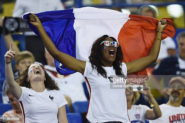 France supporters cheer during the FIFA Women's World Cup Canada 2015 Quarter Final match between Germany and France at Olympic Stadium on June 26...