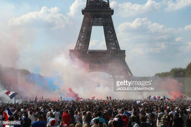 TOPSHOT France supporters cheer on the fan zone as they watch the Russia 2018 World Cup final football match between France and Croatia on the Champ...
