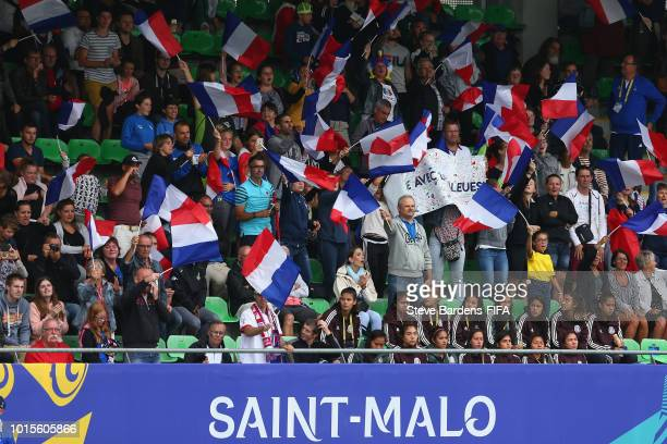 France supporters wave tricolors during the FIFA U20 Women's World Cup France 2018 group A match between Netherlands and France at Stade de Marville...