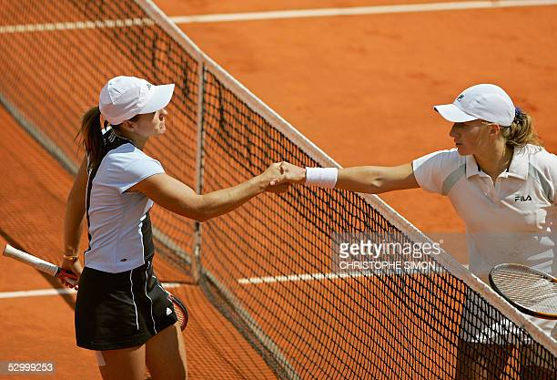 Svetlana Kuznetsova of Russia and Justine HeninHardenne of Belgium shake hands at the end of their fourth round match of the tennis French Open at...