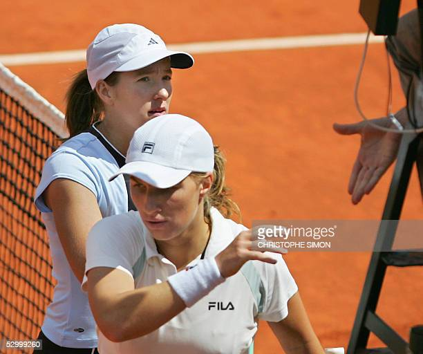 Svetlana Kuznetsova of Russia and Justine HeninHardenne of Belgium leave the central court after their fourth round match of the tennis French Open...