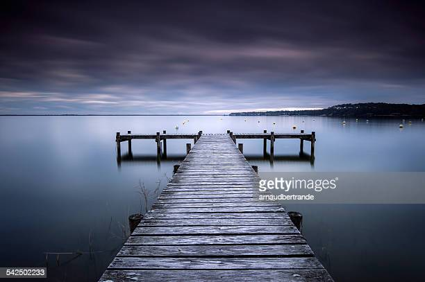 France, Symmetrical view of jetty on lake