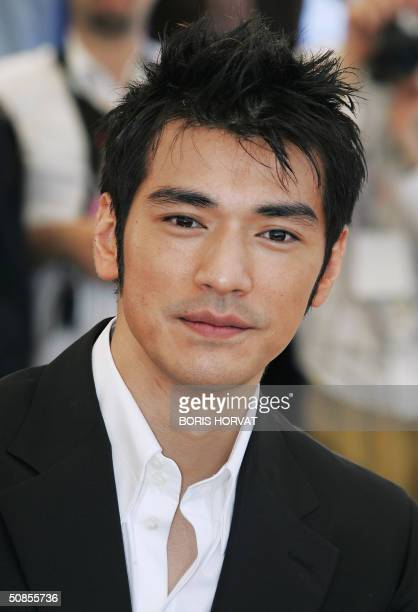 Taiwanese actor Takeshi Kaneshiro poses during a photo call for Chinese director Zhang Yimou's film House of Flying Daggers which is being shown out...