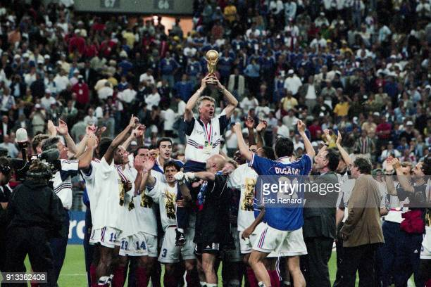 France team and his coach Aime Jacquet celebrate the victory after the Soccer World Cup Final between Brazil and France on July 12 1998 in Paris...