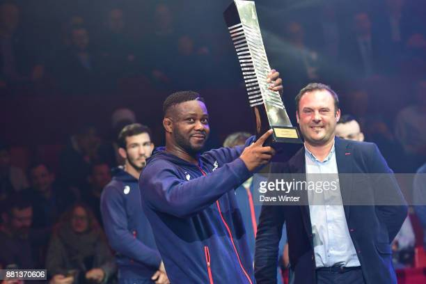 France team captain Melonin Noumonvi of France holds up the winning team trophy following the International wrestling test match between France and...
