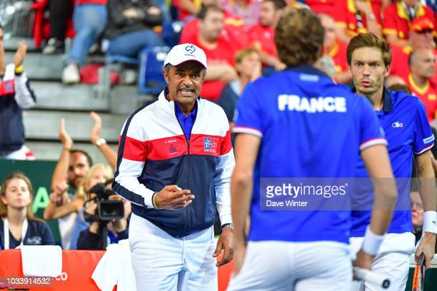 France team captain Yannick Noah offers encouragement to Julien Benneteau of France and Nicolas Mahut of France during Day 2 of the Davis Cup semi...
