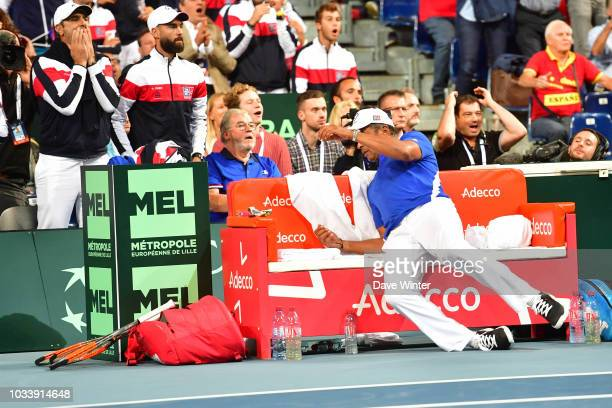 France team captain Yannick Noah slips off his bench during Day 2 of the Davis Cup semi final on September 15 2018 in Lille France