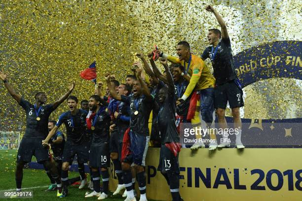 France team jump from the podium in celebration as Hugo Lloris lifts the World Cup trophy following the 2018 FIFA World Cup Final between France and...