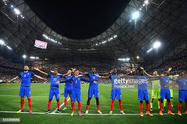 France team members celebrate after beating Germany 20 in the Euro 2016 semifinal football match between Germany and France at the Stade Velodrome in...