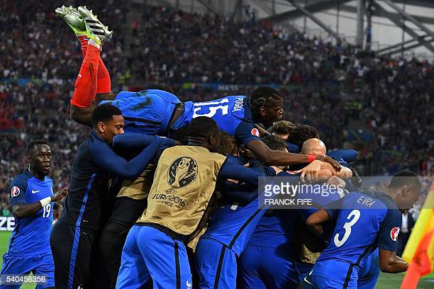 France teammates celebrate after beating Albanian 20 in the Euro 2016 group A football match between France and Albania at the Velodrome stadium in...