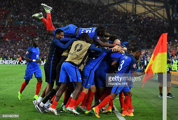 TOPSHOT France teammates celebrate their 20 win over Albania in the Euro 2016 group A football match between France and Albania at the Velodrome...