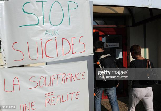 France Telecom workers enter the working place on September 28 2009 in AnnecyleVieux of a France Telecom employee who jumped today to his death from...