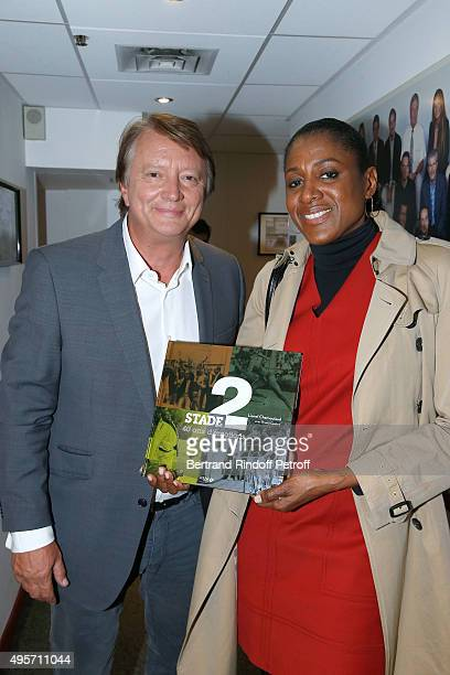 France Television Journalist Lionel Chamoulaud presents his Book 'Stade 2 40 ans d'emotion' to MarieJose Perec during the 'Vivement Dimanche' French...