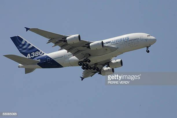 The new superjumbo Airbus A380 flies over Le Bourget airport during its 14 June 2005 flying display at Le Bourget Paris Air Show AFP PHOTO PIERRE...