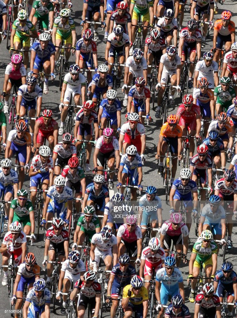 The pack rides during the 17th stage of the 91st Tour de France cycling race between Bourg-d'Oisans and Le Grand Bornand, 22 July 2004.