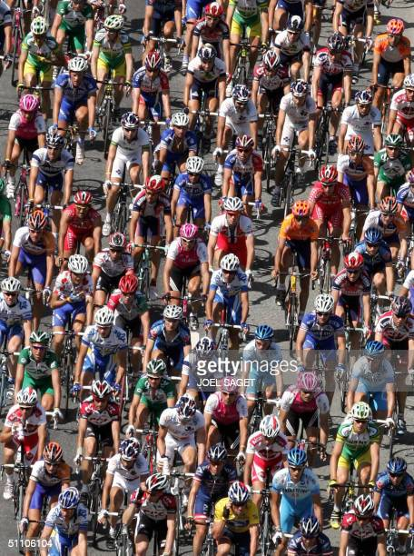 The pack rides during the 17th stage of the 91st Tour de France cycling race between Bourgd'Oisans and Le Grand Bornand 22 July 2004 AFP PHOTO JOEL...