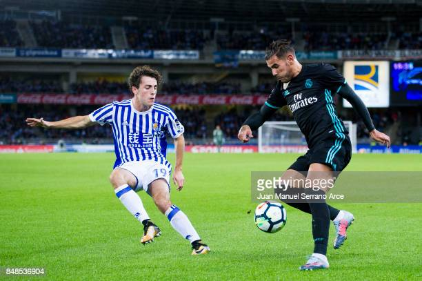 France Theo Hernandez of Real Madrid duels for the ball with Alvaro Odriozola of Real Sociedad during the La Liga match between Real Sociedad de...
