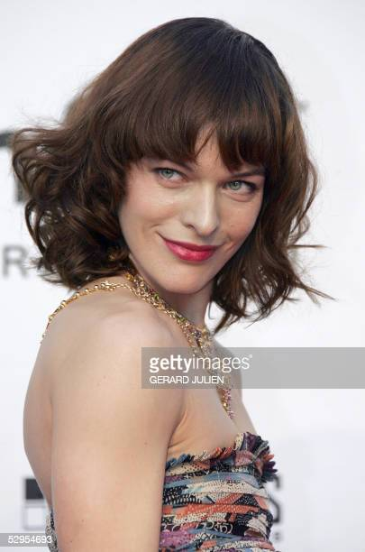 """Ukrainian-born actress and model Milla Jovovich poses as she arrives for the American Foundation for AIDS Research """"Cinema Against AIDS"""" benefit in..."""