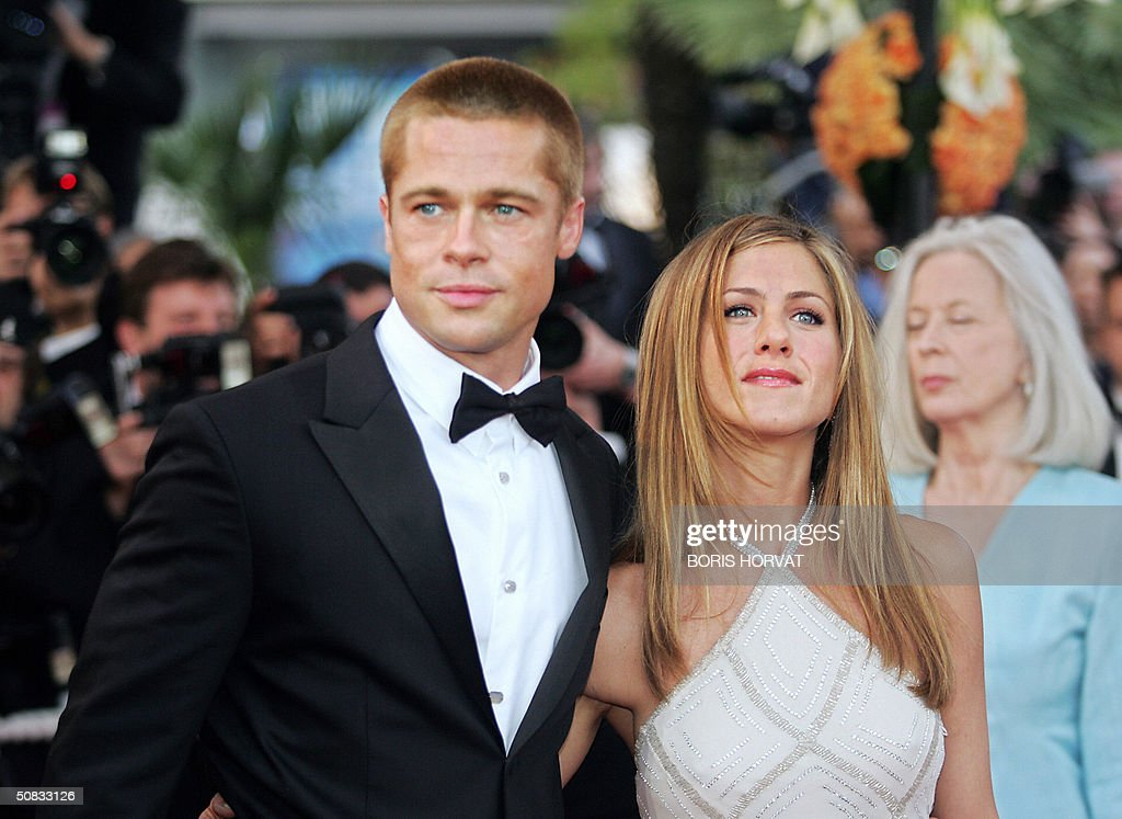US actor Brad Pitt and his wife Jennifer Aniston arrive for the official projection of US director Wolfgang Petersen's (5R) film 'Troy' , 13 May 2004, at the 57th Cannes Film Festival in the French Riviera town. Hollywood took over the French Riviera today as Brad Pitt and his co-stars of the epic movie arrived to present their 175 million dollar (147 million euro)-plus swords-and-sandals feature, being shown out of competition, in the blaze of Cannes publicity.