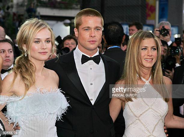 US actor Brad Pitt and his wife Jennifer Aniston arrive with German actress Diane Kruger to attend the official projection of US director Wolfgang...