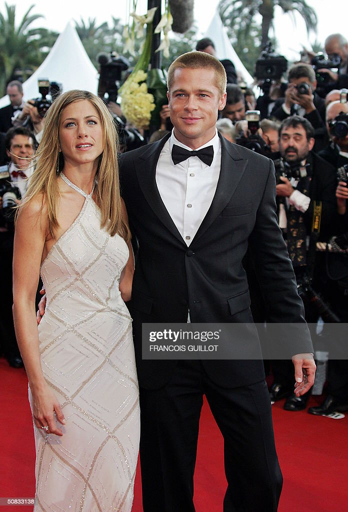 US actor Brad Pitt (R) and his wife Jennifer Aniston pose photographers on the red carpet as they arrive for the official projection of US director Wolfgang Petersen's (5R) film 'Troy' , 13 May 2004, at the 57th Cannes Film Festival in the French Riviera town. Hollywood took over the French Riviera today as Brad Pitt and his co-stars of the epic movie arrived to present their 175 million dollar (147 million euro)-plus swords-and-sandals feature, being shown out of competition, in the blaze of Cannes publicity.