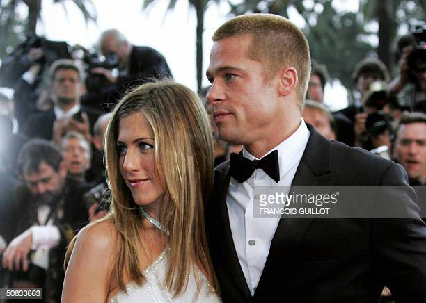 US actor Brad Pitt and his wife Jennifer Aniston to attend the official projection of US director Wolfgang Petersen's film Troy 13 May 2004 at the...