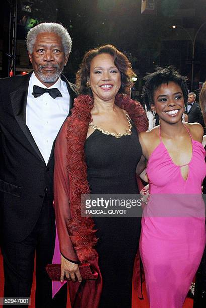 US actor Morgan Freeman his wife Myrna ColleyLee and daughter Deena pose as they arrive for the screening of US directors Frank Miller and Robert...