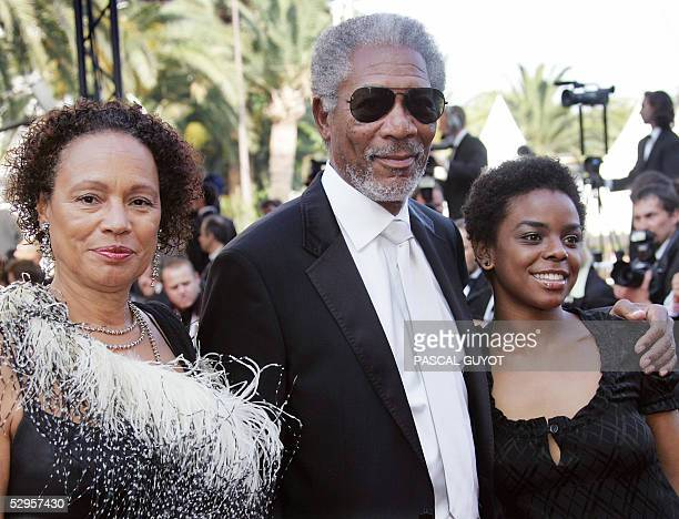 Actor Morgan Freeman , his wife Myrna Colley-Lee and daughter Deena pose as they arrive for the screening of US actor/director Tommy Lee Jones' film...