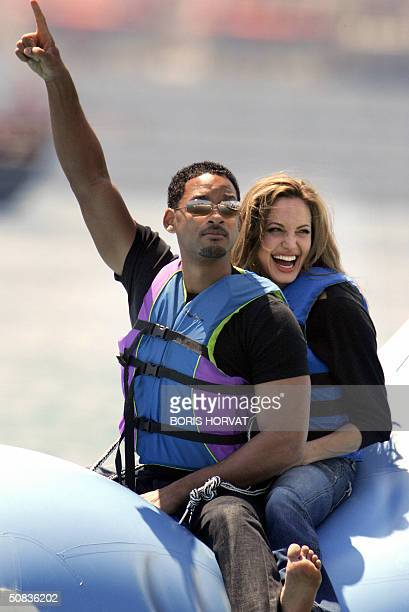US actor Will Smith and US actress Angelina Jolie ride into shore at the Carlton Hotel beach on a promo float for their film 'Shark Tale' 14 May 2004...