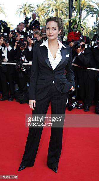 US actress Angelina Jolie arrives 15 May 2004 for the official projection of 'Shrek 2' at the Cannes Film Festival in the French Riviera town The...