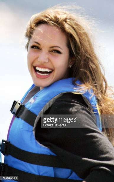 US actress Angelina Jolie smiles during a photo call at the Carlton Hotel beach for the film 'Shark Tale' 14 May 2004 at the 57th Cannes Film...