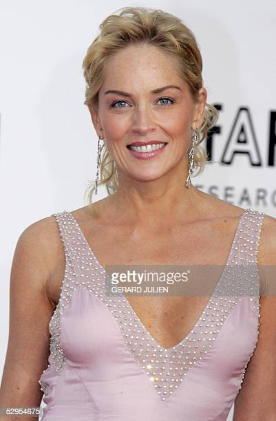 """Actress Sharon Stone poses as she arrives for the American Foundation for AIDS Research """"Cinema Against AIDS"""" benefit in Le Moulin de Mougins, 19 May..."""