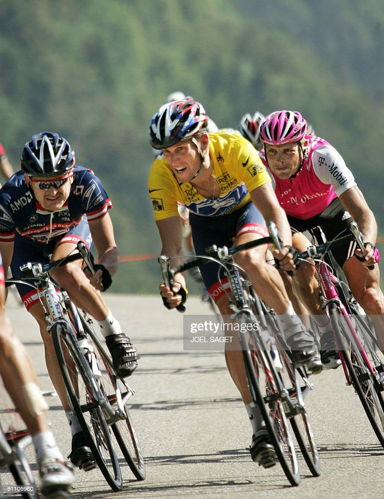US Lance Armstrong (US Postal/USA) (C) rides with his teammate Floyd Landis (L) and German Jan Ullrich (T-Mobile/Ger) during the 17th stage of the 91st Tour de France cycling race between Bourg-d'Oisans and Le Grand Bornand, 22 July 2004.