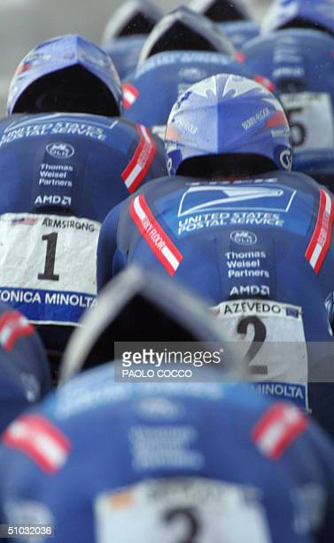 Postal team rides during the fourth stage of the 91st Tour de France cycling race, a team time trial between Cambrai and Arras, 07 July 2004. The tem...