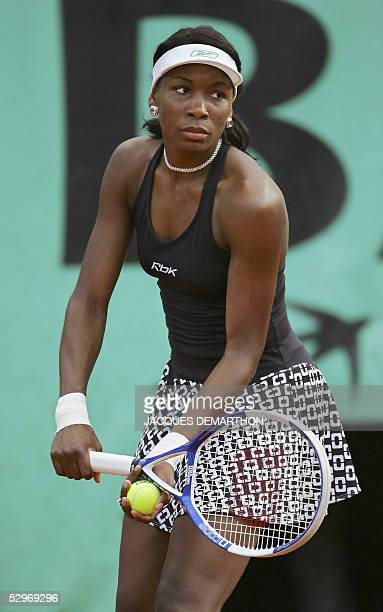 US Venus Williams prepares to serve to Spanish Marta Marrero during their match for the first round of the Tennis French Open at Roland Garros 23 May...