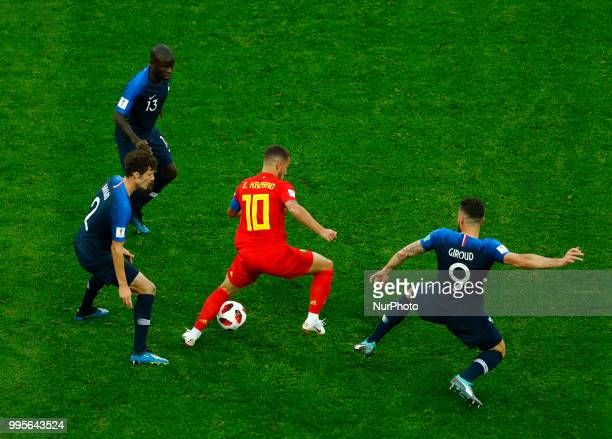 France v Belgium Semifinal FIFA World Cup Russia 2018 Eden Hazard against Benjamin Pavard Ngolo Kante and Olivier Giroud at Saint Petersburg Stadium...