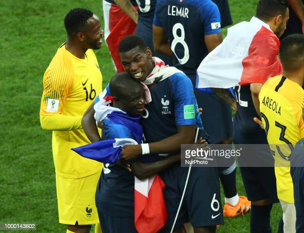 France v Croatia FIFA World Cup Russia 2018 Final Paul Pogba and Ngolo Kante celebrate with france flags on the pitch at Luzhniki Stadium in Moscow...