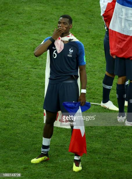 France v Croatia FIFA World Cup Russia 2018 Final Paul Pogba celebrates with the france flag during the award ceremony at Luzhniki Stadium in Moscow...