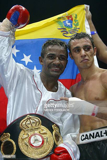 Venezuelan Lorenzo Parra poses with his belt after winning over France's Sydney olympic gold medallist Brahim Asloum of France at the end of their...