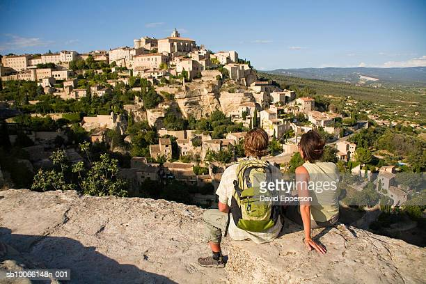 France, Village of Gordes, couple looking at village, rear view