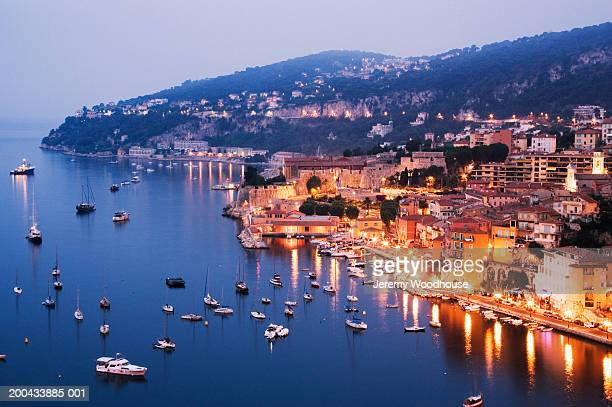 france, villfranche sur mer, town at dawn, elevated view - french riviera stock pictures, royalty-free photos & images