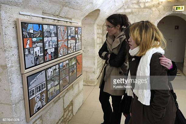ANGOULEME France Visitors on Jan 30 look at cartoons in a special exhibition by the South Korean government on wartime sex slavery at an...