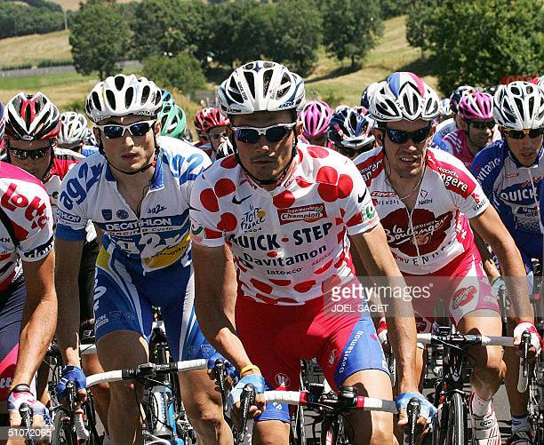 White-and-red polka dotted jersey of best climber Richard Virenque takes the start of the 11th stage of the 91st Tour de France cycling race between...