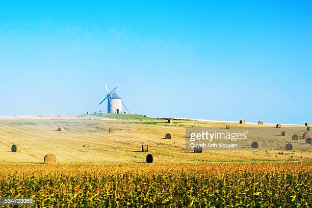France, windmill in a harvested field
