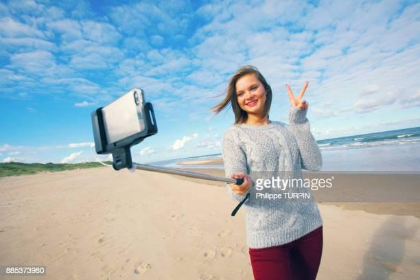 France, woman doing selfie.