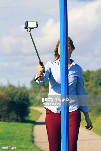 france, woman doing selfie. - careless stock pictures, royalty-free photos & images