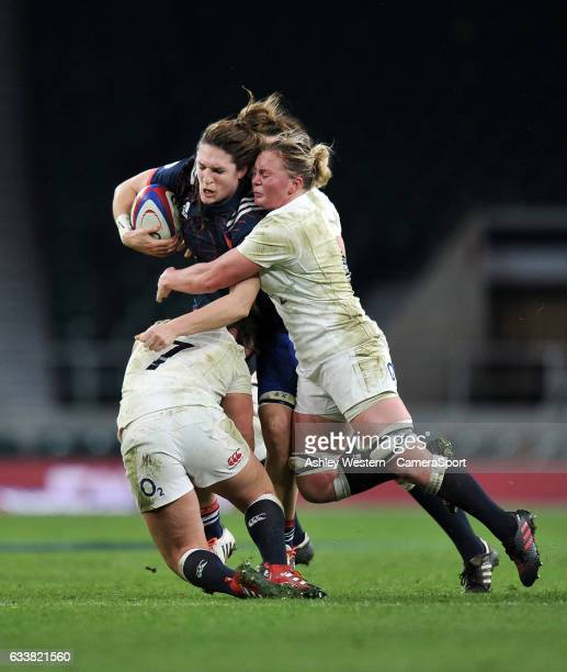 France Womens Lenaig Corson is tackled by England Womens Izzy NoelSmith and Marlie Packer during the Women's Six Nations match between England Women...