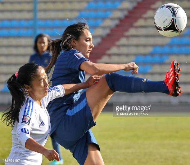 France women's national football team midfielder Louisa Necib vies with Kazakhstan's women's national football team defender Ulbosin Zholchiyeva...